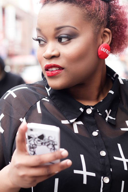 cell phone and iafro earrings